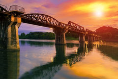 Colorful twilight time of river khaw bridge in kanchanaburi most royalty free stock images