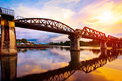 Colorful twilight time of river khaw bridge in kanchanaburi most. Popular world war II history traveling destination in western of thailand Stock Photography
