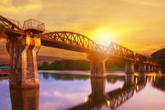 Colorful twilight time of river khaw bridge in kanchanaburi most. Popular world war II history traveling destination in western of thailand Royalty Free Stock Photo