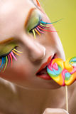 Colorful twisted lollipop and colorful extreme fashion makeup Stock Photography