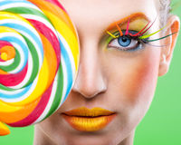 Colorful twisted lollipop, colorful fashion makeup Royalty Free Stock Photography