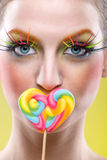 Colorful twisted lollipop and colorful fashion makeup Royalty Free Stock Photo