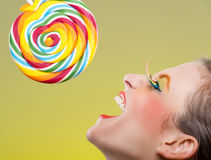 Colorful twisted lollipop and colorful fashion makeup Royalty Free Stock Photography