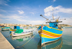 Colorful typical boats at harbour Marsaxlokk in Malta Royalty Free Stock Images