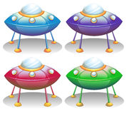Colorful UFO saucers. Illustration of the colorful UFO saucers on a white background royalty free illustration
