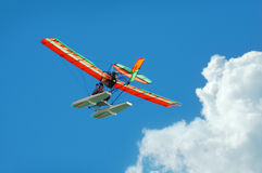 Colorful ultralight airplane. Ultralight aircraft with clouds in the background Royalty Free Stock Photo