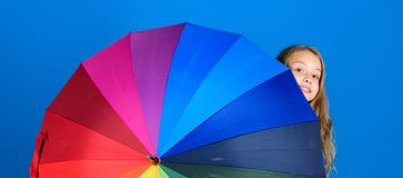 Colorful umbrella accessory. Weather forecast concept. Stay positive though rainy day. Brighten up life. Kid peek out. Colorful rainbow umbrella. Color your royalty free stock photos
