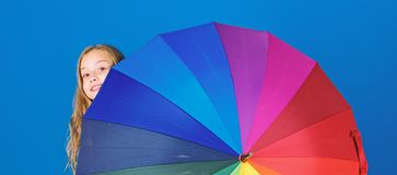 Colorful umbrella accessory. Weather forecast concept. Stay positive though rainy day. Brighten up life. Kid peek out. Colorful rainbow umbrella. Color your royalty free stock images