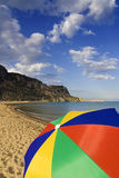 Colorful umbrella on a beach Stock Images