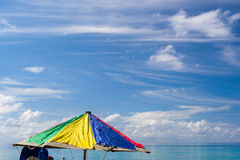 Colorful Umbrella on a Beach in the Caribbean Royalty Free Stock Photo