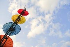 Colorful umbrella on blue sky Royalty Free Stock Photos