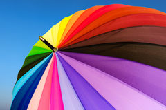 Colorful umbrella. On blue sky background Stock Photography