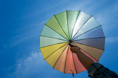 Colorful umbrella on blue sky Royalty Free Stock Image