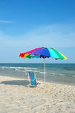 Colorful Umbrella and Chair Stock Images