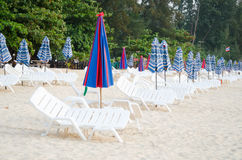 Colorful Umbrella and chair on the beach in Summer at Phuket Tha Stock Photos