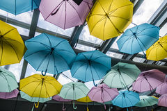 Colorful umbrella. Decoration under glass roof Royalty Free Stock Images