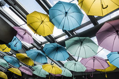 Colorful umbrella. Decoration under glass roof Stock Photography