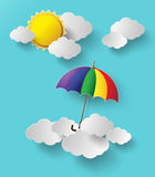 Colorful umbrella flying high in the air. Paper cut style stock illustration