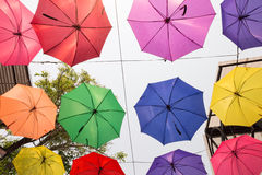 colorful umbrella hanging on the rope Stock Image