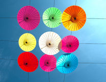 Colorful umbrella hanging on the sky. Royalty Free Stock Images