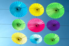 Colorful umbrella  hanging on the sky. Stock Photo