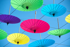 Colorful umbrella hanging on the sky. Royalty Free Stock Image