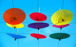 Colorful umbrella hanging on the sky. Stock Image