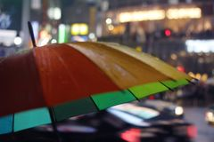 Colorful umbrella with neon lights in the background royalty free stock photos