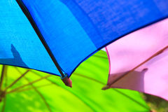 Colorful umbrella. Pink blue green Royalty Free Stock Photo