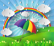 Colorful umbrella in the rain with rainbow. Royalty Free Stock Photography
