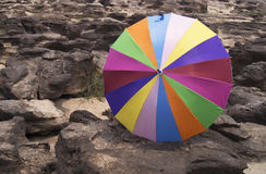 Colorful umbrella on rock. Background in Sampanbok of Maekong river, Thailand Stock Photography