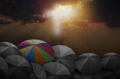 Colorful umbrella on rock stock image