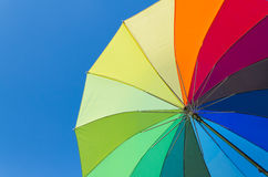 Colorful umbrella on a sky background. Colorful umbrella on a bright blue sky background Stock Photos