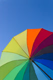 Colorful umbrella on a sky background. Colorful ambrells on a bright blue sky background, vertical view Stock Images