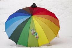A colorful umbrella in the snow Royalty Free Stock Images