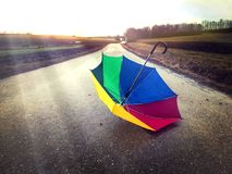 Colorful umbrella on a way. Colorful umbrella on a wet, rainy day Royalty Free Stock Photo