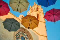 Colorful umbrellas against gothic cathedral. Royalty Free Stock Images