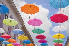 Colorful umbrellas against the sky in city stock photography