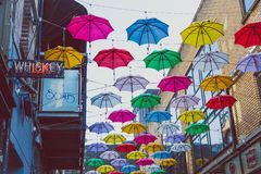 Colorful umbrellas art installation in frot of the Zozimus bar i. DUBLIN, IRELAND - April 14th, 2018: colorful umbrellas art installation in frot of the Zozimus Royalty Free Stock Image