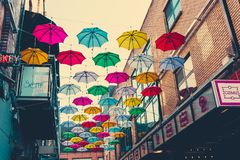 Colorful umbrellas art installation in frot of the Zozimus bar i. DUBLIN, IRELAND - April 14th, 2018: colorful umbrellas art installation in frot of the Zozimus Royalty Free Stock Photo