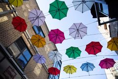 Colorful umbrellas art installation in frot of the Zozimus bar i. DUBLIN, IRELAND - April 14th, 2018: colorful umbrellas art installation in frot of the Zozimus Stock Photo