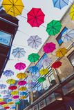 Colorful umbrellas art installation in frot of the Zozimus bar i. DUBLIN, IRELAND - April 14th, 2018: colorful umbrellas art installation in frot of the Zozimus Stock Photos