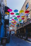 Colorful umbrellas art installation in frot of the Zozimus bar i. DUBLIN, IRELAND - April 14th, 2018: colorful umbrellas art installation in frot of the Zozimus Royalty Free Stock Photos