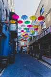 Colorful umbrellas art installation in frot of the Zozimus bar i. DUBLIN, IRELAND - April 14th, 2018: colorful umbrellas art installation in frot of the Zozimus Stock Images