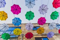 Colorful umbrellas art installation in frot of the Zozimus bar i. DUBLIN, IRELAND - April 14th, 2018: colorful umbrellas art installation in frot of the Zozimus Royalty Free Stock Images