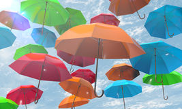 Colorful umbrellas background. Bright colorful umbrellas on blue sky background Royalty Free Stock Images