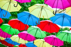 Colorful umbrellas background. Colorful umbrellas in the sky as decoration stock photo