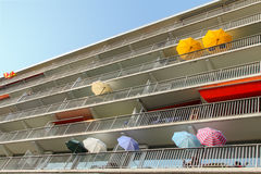 Colorful umbrellas on balconies in Amsterdam. Colorful umbrellas on balconies of an apartment complex at the Delfland square in Amsterdam the Netherlands royalty free stock photo