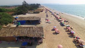 Colorful umbrellas on the beach. An aerial drone shot on the beach. Colorful umbrellas are seen in the shot stock video footage