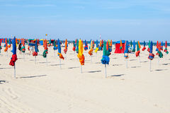 Colorful umbrellas on the beach of Deauville France. Stock Photo